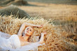 Bride resting in hay stack