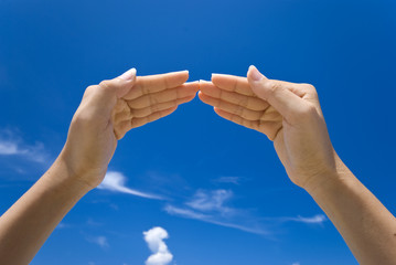 Hand symbolizing a house