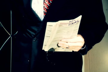 tilt businessman walking out door tinted