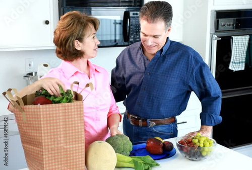 Couple Fresh Produce laughing