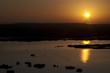 Beautiful African sunrise, reflected on lake in Kenya.