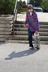 Teenage skateboarder about to start skating