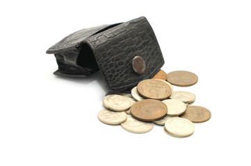old leather purse and coins isolated on white