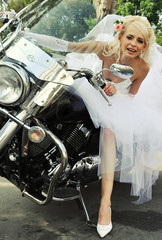 Beautiful young bride on a motorbike