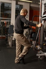 a male bodybuilder working out in gym