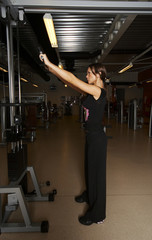 a female bodybuilder working out in gym