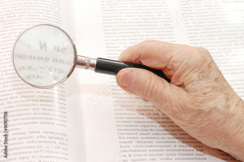 image of magnifier in old hand