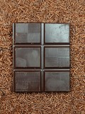 Chocolate granules and bars background poster