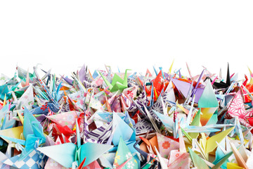 A pile of paper birds. Shallow depth of field.
