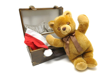 Old case with chrismas hat and teddybear