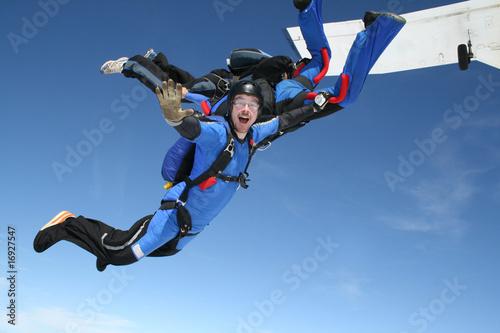 Spoed canvasdoek 2cm dik Luchtsport Skydiver waves at the camera