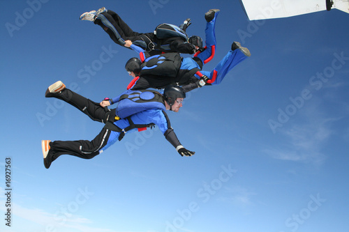 Three skydivers jump from aplane