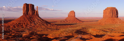 Leinwandbild Motiv Colored Monument Valley during sunset