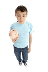 Boy holding a piggy bank money box