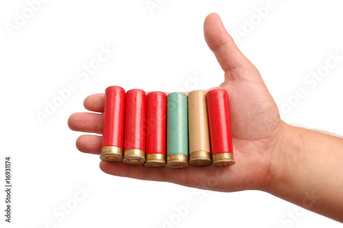 Man's hand with the hunting cartridges