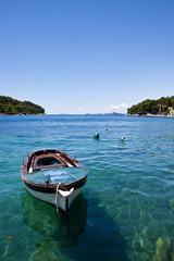 Blue Boat on Blue Water