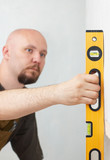 Worker with yellow level measuring angle