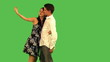 couple playing with camera over green screen