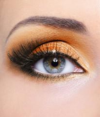 Woman eye with orange make-up