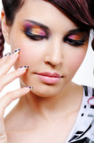 Face of woman with multicolored eyeshadows poster