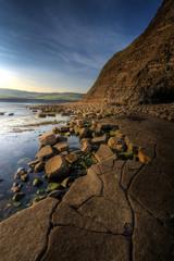 Dusk over rocky coastline