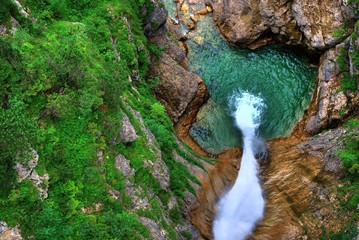 waterfall from above in a green pot