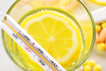 Thermometer and lemon, abstract medical background