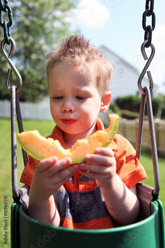 Boy eating melon