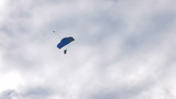 HD skydiving in blue sky with clouds
