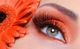 false eyelashes and fashion orange eye make-up poster