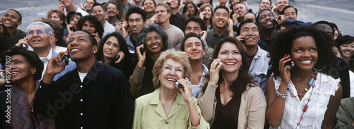 Crowd of people using mobile phones, outdoors