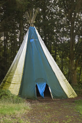 A teepee at a campsite in the woods