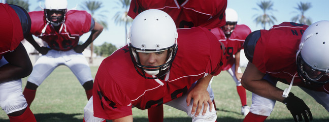 American football players during game