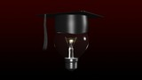 Light bulb with a graduated hat on. Concept of smart head