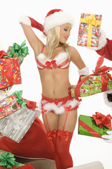 Mrs Claus in underwear surrounded by gifts
