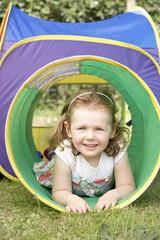 Young Girl Crawling Through Play Equipment