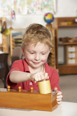 Young Boy Playing at Montessori/Pre-School