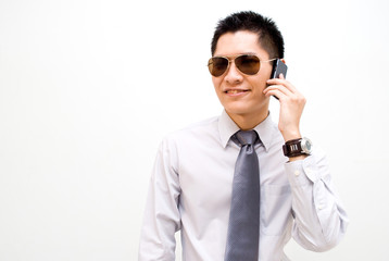 Asian business male on mobile call
