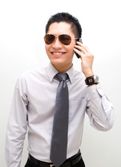 Cool businessman on mobile with glasses