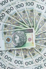 background made of polish 100 zloty banknotes