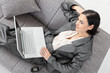 Businesswoman sitting on sofa