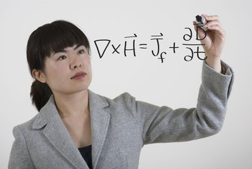 woman writing advanced math equation