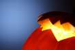 Glowing halloween pumpkin detail, abstract background