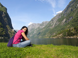 Woman relaxing in the fjord of Gudvangen poster