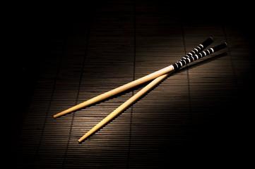 Japanese chopsticks on bamboo mat