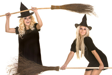 Two Halloween witch in black dress and hat on broom banner.