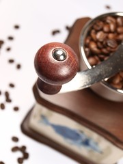 Detail of coffee grinder on white background