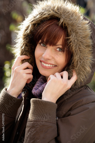 Portrait of beautiful young woman wearing fur hood