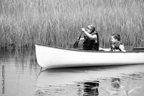 children paddling through wetlands