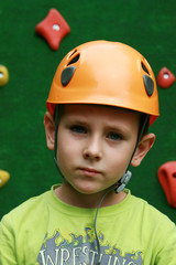 Boy and climbing wall